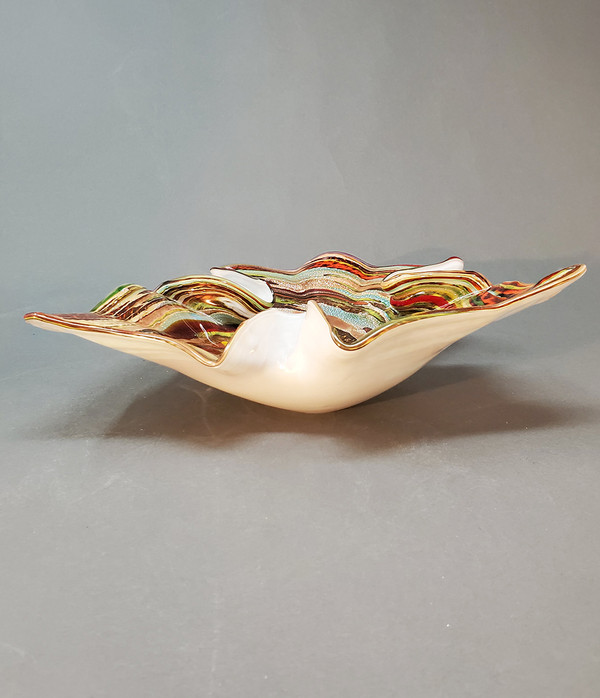 Italian blown glass dish with colors on top and white underneath.