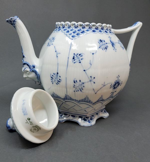 Royal Copenhagen face teapot with lid off.