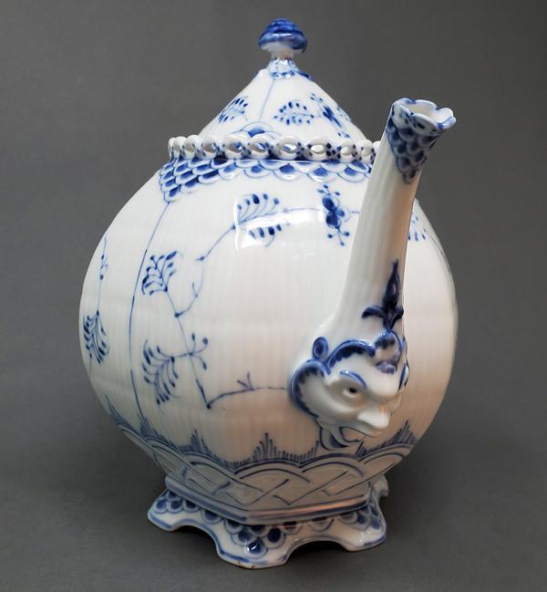 Royal Copenhagen teapot 1119 with little faces.
