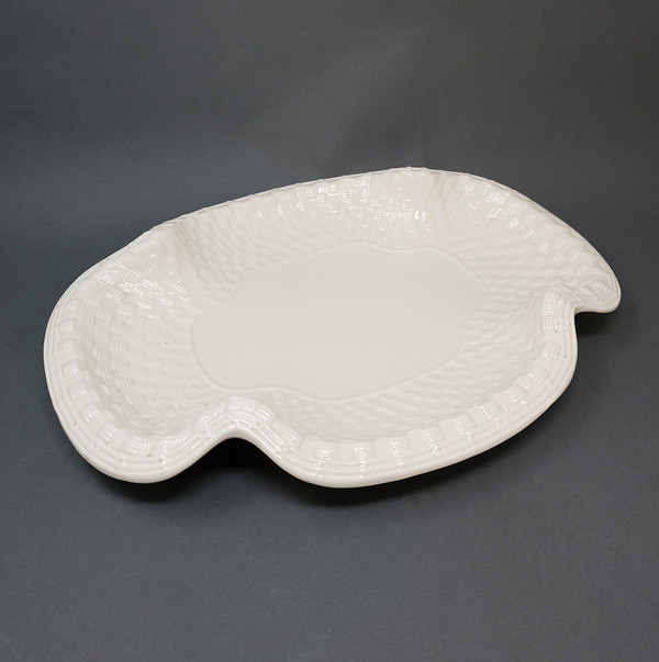 Porcelain plate by Spode in organic shape with basket pattern.