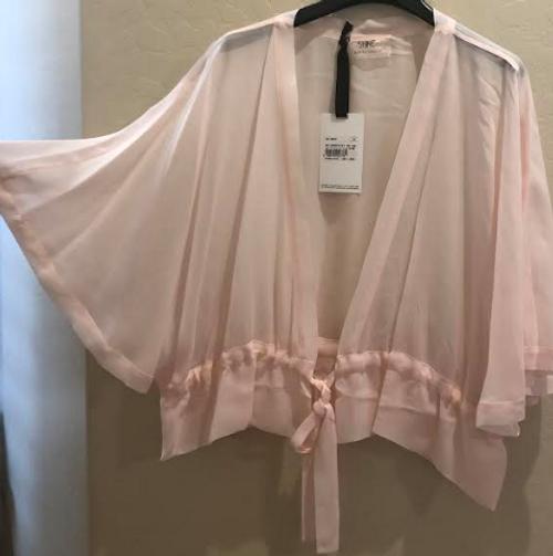 Soft pink shrug