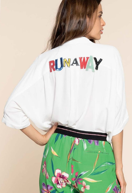 "Gorgeous Casual Yacht Wear From Italy, white free flowing blouse with ""Runaway"" on the back of the blouse in elegant bright colors."