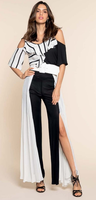 Made In Italy, Gorgeous ultra fashion open slit pant. This pant is black with a alluring white fan effect half skirt. One of kind fashion statement, stunning look. If you have long legs and amazing ankles, this is a must have. 100% Polyester
