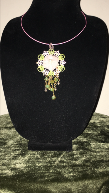 Italian gem with baby pink and green flower patterned lattice complemented with a flower ornate with a pearl centerpiece. Handmade with certificate of authenticity