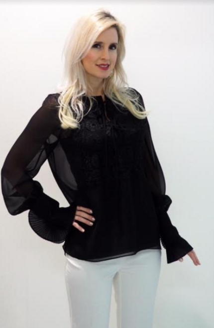 Sheer black blouse with accordion wrist sleeve