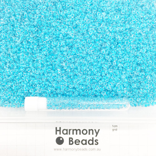 Glass Seed Beads 8/0 Inside Colour-Lined Clear with Medium Aqua Blue [5 gram tube]
