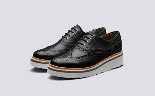 Emily   Womens Brogue in Black Leather with White Wedge Sole   Grenson  - Main View