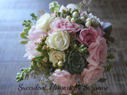 bride bouquet with fresh flowers and succulents