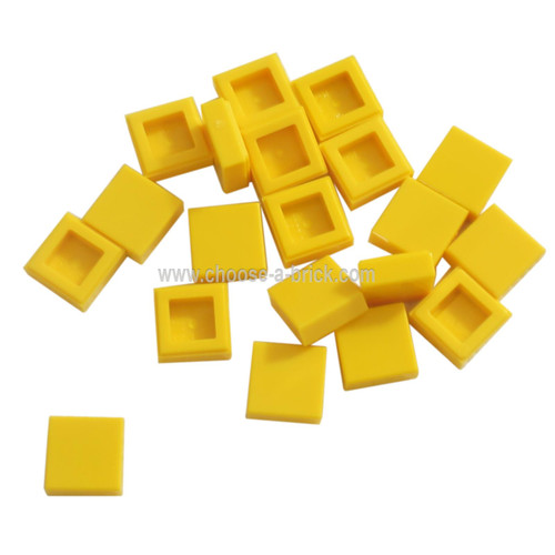 Tile 1 x 1 with Groove yellow
