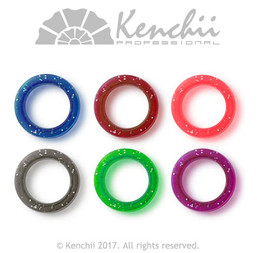 Finger inserts for shears. Blue, red, pink, black, green, and purple.