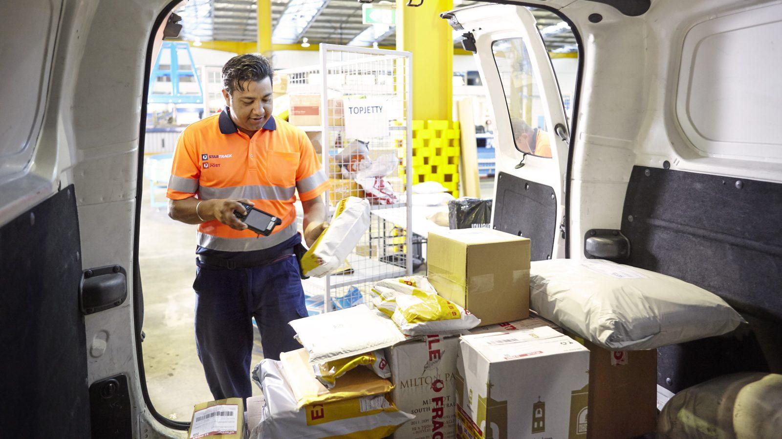 photo-delivery-driver-scanning-parcels-back-of-van.jpg.auspostimage.1600-0.medium.jpg