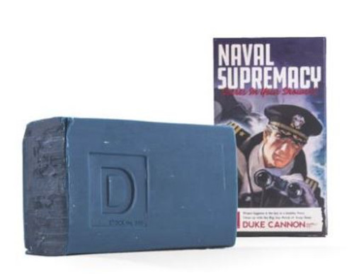 """SOAP NAVAL SUPREMACY While other blue soaps are named """"Ocean Force"""" or """"Summer Mist,"""" our blue soap is the only one big enough to be named """"Naval Supremacy."""" With a package sporting the official colors of the U.S. Navy, this superior grade product weighs in at a hefty 10 oz. and has steel cut grains for maximum grip.  To honor the military heritage of our Big Ass Bricks of Soap, this particular item comes in our limited edition WWII-era propaganda package, reminding you that """"Naval Supremacy Starts in Your Shower.""""  Smells Like Naval Supremacy (refreshing ocean scent)  1 10 oz. brick.  INGREDIENTS: SODIUM TALLOWATE, SODIUM COCOATE, FRAGRANCE, AVENA SATIVA (OAT) KERNEL FLOUR, IRON OXIDES, ULTRAMARINE BLUE, BLUE 1."""