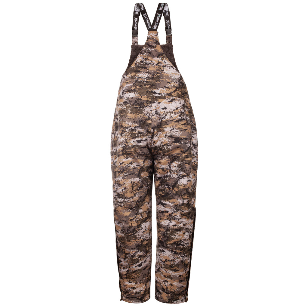 Rear View: Disruption® bib overalls have adjustable elastic shoulder straps.