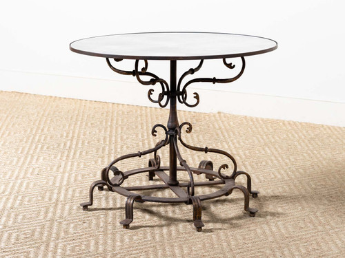 ANTIQUE EIGHT-FOOTED IRON TABLE