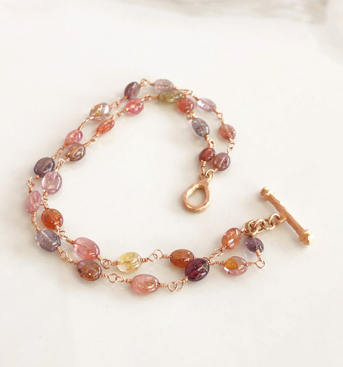 Talisman Gumdrop Spinel Bracedlet- multi color cabachon natural gemstone. 18K Rose gold with handmade toggle. So soft and romantic, the colors are gentle and warm. Fits average wrist 7""