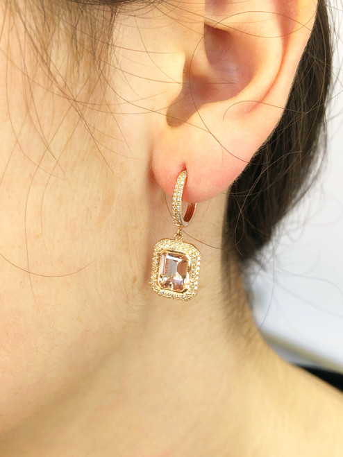 Morganite drop earring with diamonds on model's ear