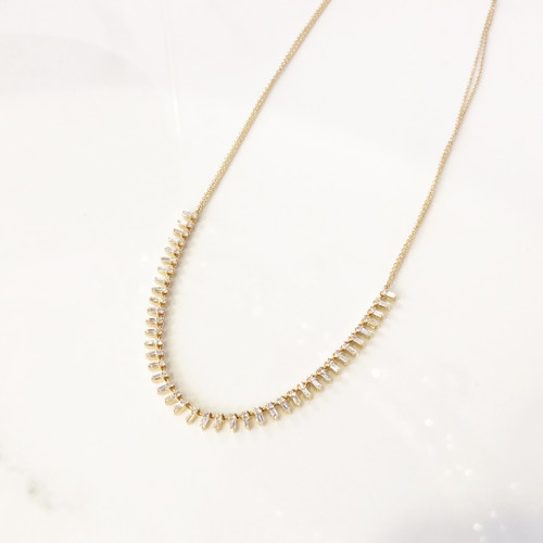 view of baguette & diamond necklace in 14K yellow gold