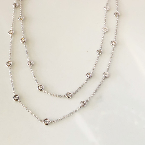 close up of double diamond bezel necklace