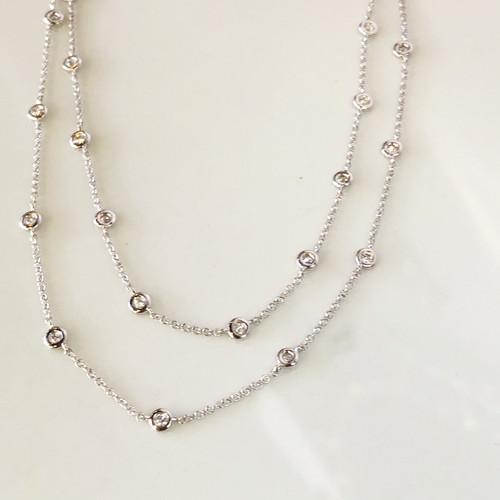 close up of double diamond bezel necklace