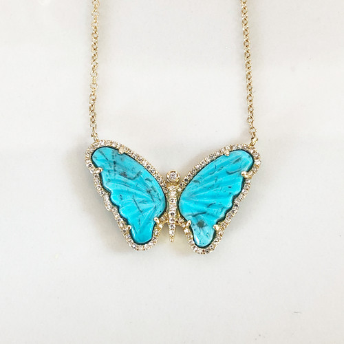 close up photo of butterfly necklace
