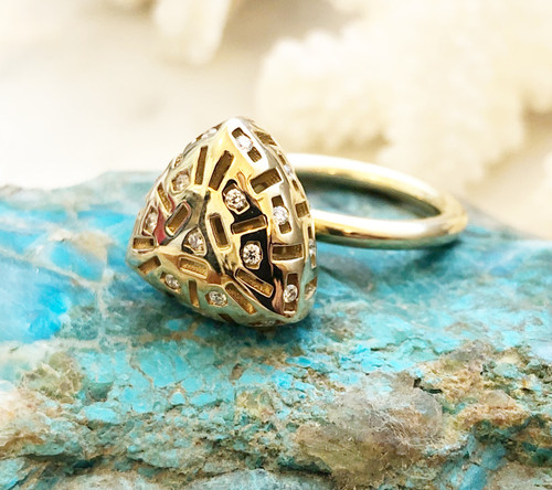 three quarter front view of moonbeam ring on rock