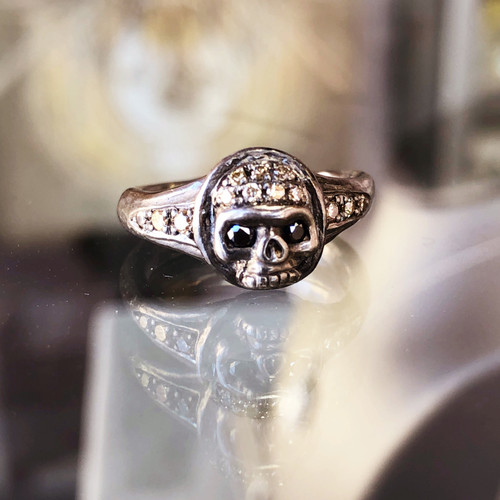 front view of Roman Paul ladies skull ring with champagne & Black diamonds