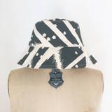 worn black flying carpet bucket hat