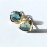 Blue topaz folded studs with sterling somber and 14K gold. Sterling silver posts.