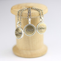 Tiny Silver and Bronze Word Charm
