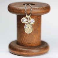 Tiny Silver and Bronze Oval Charm