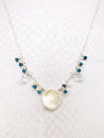 Martinique Necklace- A Keshi Pearl pendant with mesmerizing Emerald Swarovski crystals and Freshwater Pearls on Sterling Silver adjustable chain.