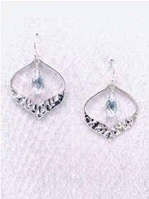Petaluma Earrings – Blue Shade Swarovski Crystal suspended in a Sterling Silver Petal Pendant with a Hammer Texture Bottom Edge. Handcrafted in Cape Charles, VA.