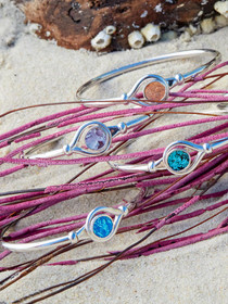 Samoa Bracelet– Sterling Silver bangle Bracelet inset with Genuine Metallic Icelandic Fish Leather handcrafted in Cape Charles, Va.