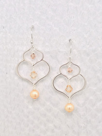 Marbella Earrings – Colorado Topaz Swarovski Crystals and Champagne Freshwater Pearls cascading down dainty Sterling Silver petal shaped pendants. Handcrafted in Cape Charles, VA.