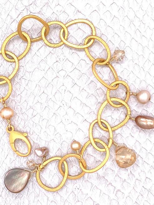 Belmopan Bracelet–Grey Lip Shell, Freshwater Pearls and Golden Shadow Swarovski Crystals enhance this Gem Quality 24K-plated bracelet.