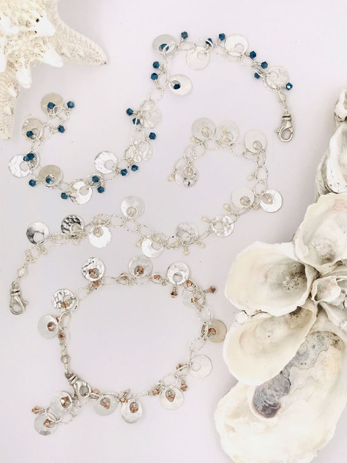 Chantilly Bracelets– Sterling Silver Hammered Links and Discs that are embellished with either small Swarovski Crystals or Freshwater Pearls handcrafted in Cape Charles, VA.