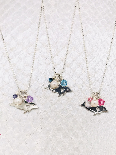 Nantucket Necklace-Sterling Silver Dolphin Charm adorned with Freshwater pearls and Swarovski Crystals suspended by Sterling Silver ball chain handcrafted by the Chesapeake bay in Cape charles, VA.