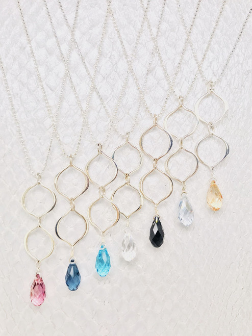 """3/4"""" Swarovski Crystal suspended by two sterling silver petal shaped links on an adjustable 16""""-19"""" Sterling Silver ball chain handcrafted in Cape Charles, VA."""