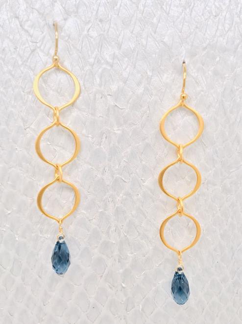Victoria Earrings– Denim Blue Swarovski Crystals suspended by Vermeil-Style organic shaped petal links handmade in Cape Charles, VA.