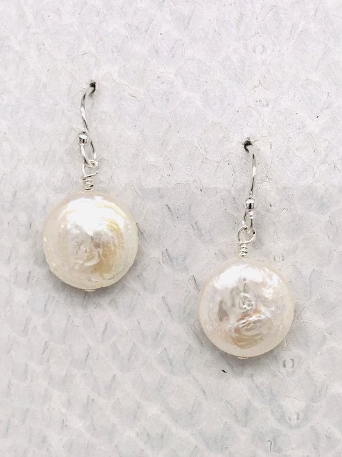 "Barcelona Earrings– 1/2"" White Freshwater Coin Pearl suspended from Sterling Silver ear wires handcrafted in Cape Charles, VA."