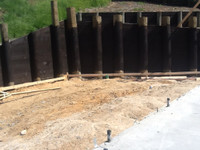 biosymph - retaining wall stained with BitPost Timber Stain and Preserver