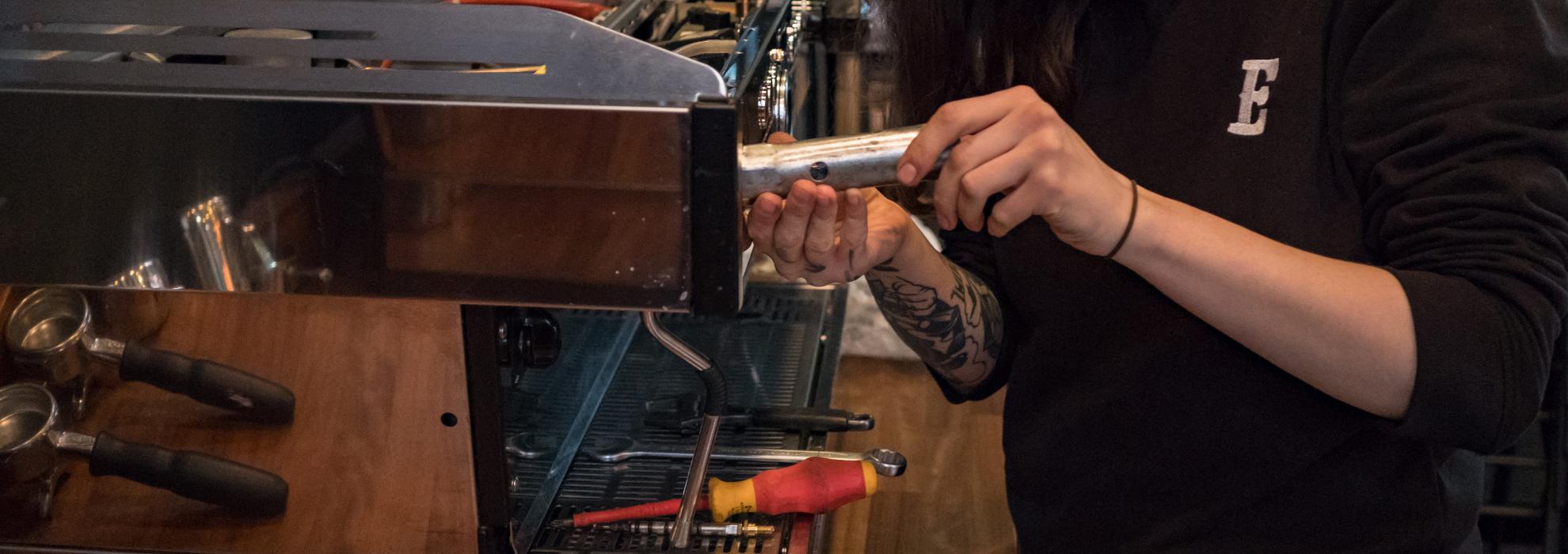 Extract Coffee Roasters Engineer Repairing a machine