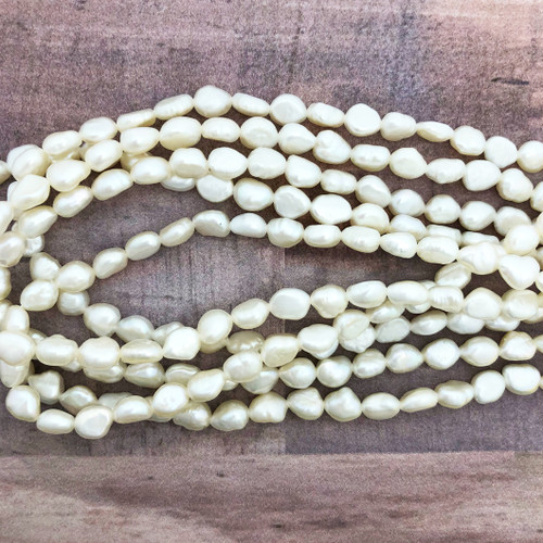 6-6.5mm White Fresh Water Pearls, Nugget (1 strand)
