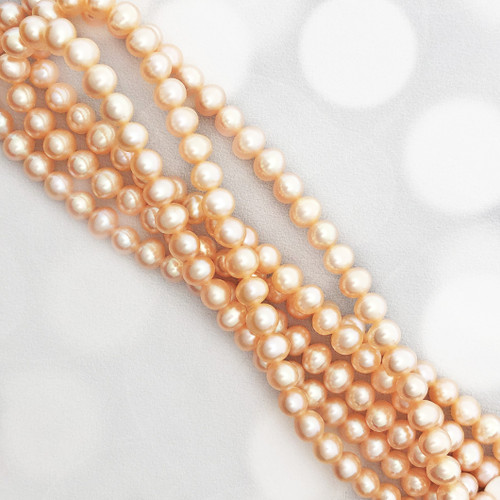 6-6.5mm Peach Fresh Water Pearls, Potato Shape (1 strand)