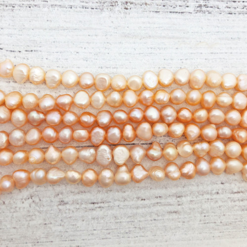7.5-8mm Peach Fresh Water Pearls, Nugget (1 strand )