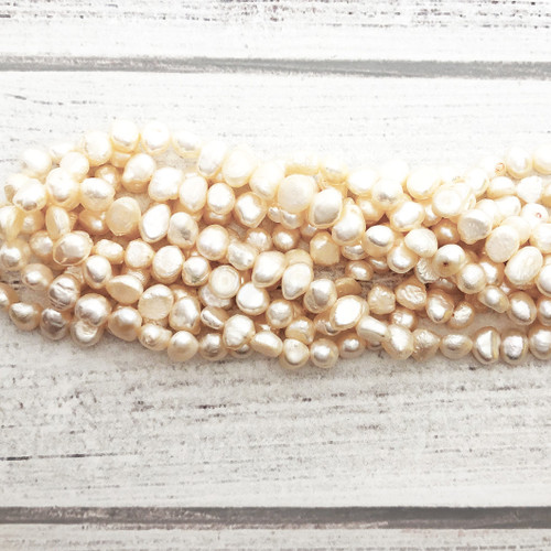 7-7.5mm White Fresh Water Pearls, Nugget (1 strand)