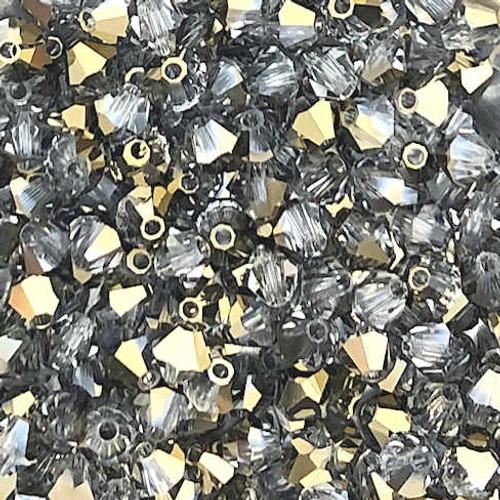 4mm Preciosa Bicones, Crystal Starlight Gold  Half (Qty: 50)