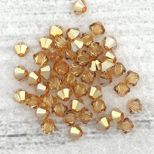3mm Swarovski Bicones, Crystal Metallic Sunshine (Qty: 50)