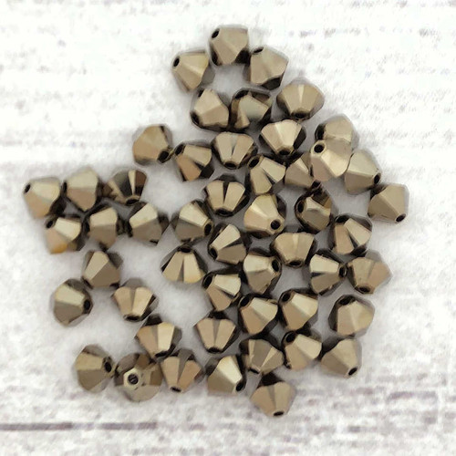 3mm Swarovski Bicones, Crystal Metallic Light Gold 2X (Qty: 50)