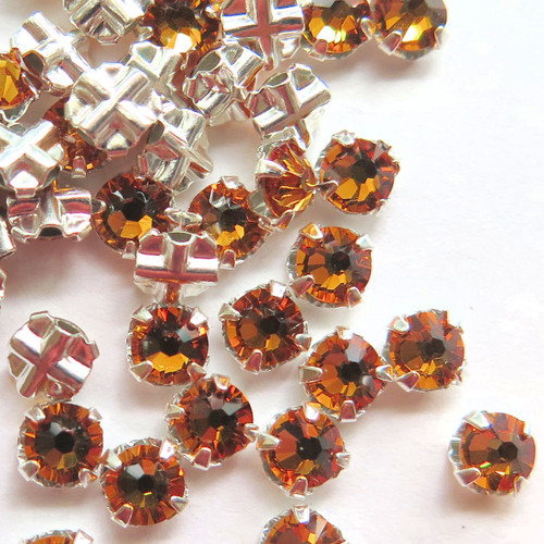 16ss Swarovski Rose Montees - Topaz (Qty: 50)